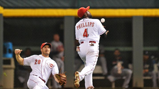 Phillips leads Reds to 1-0 victory over Braves