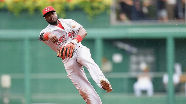 Brandon Phillips helps turn two after Price's successful challenge