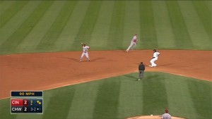 Brandon Phillips ranges far to his right and makes the off-balance throw from short to get Jose Abreu at first base.
