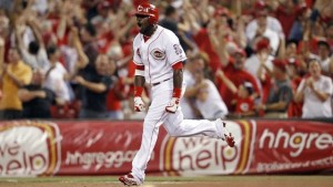 Brandon Phillips leads off the 13th inning with a home run to left field, giving the Reds a 5-4 lead.